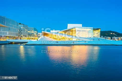 The Oslo Opera House in downtown Oslo Norway illuminated in the evening.