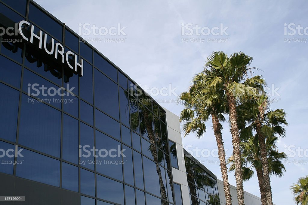 The outside of a modem church building and palm trees royalty-free stock photo