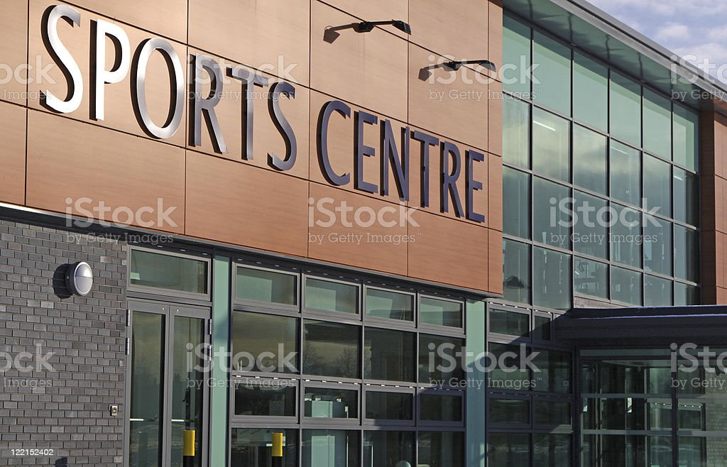The outside of a sports center building stock photo