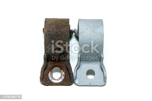 The overgrown rusty cast iron part compared with the same sand blasted part isolated in a white background.