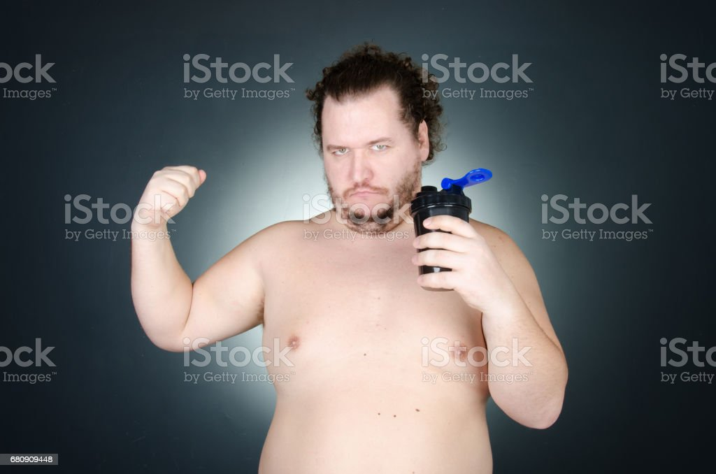 The overweight guy. Funny bodybuilding. royalty-free stock photo