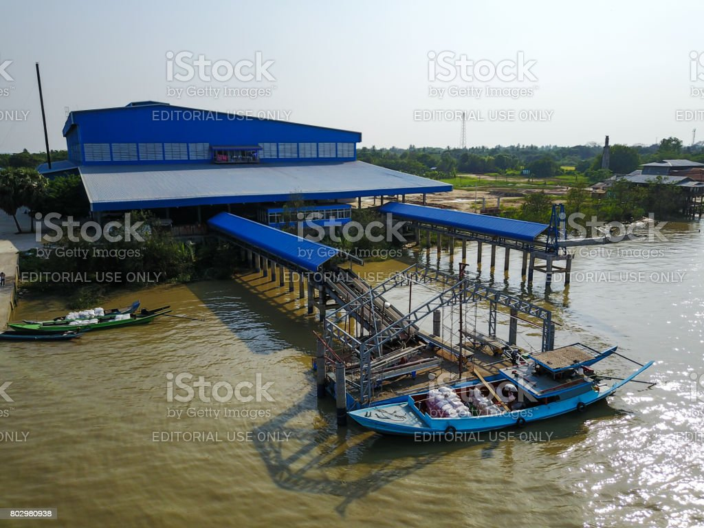 The paddy in loading at the pontoon in the intakinng area of rice mill. stock photo