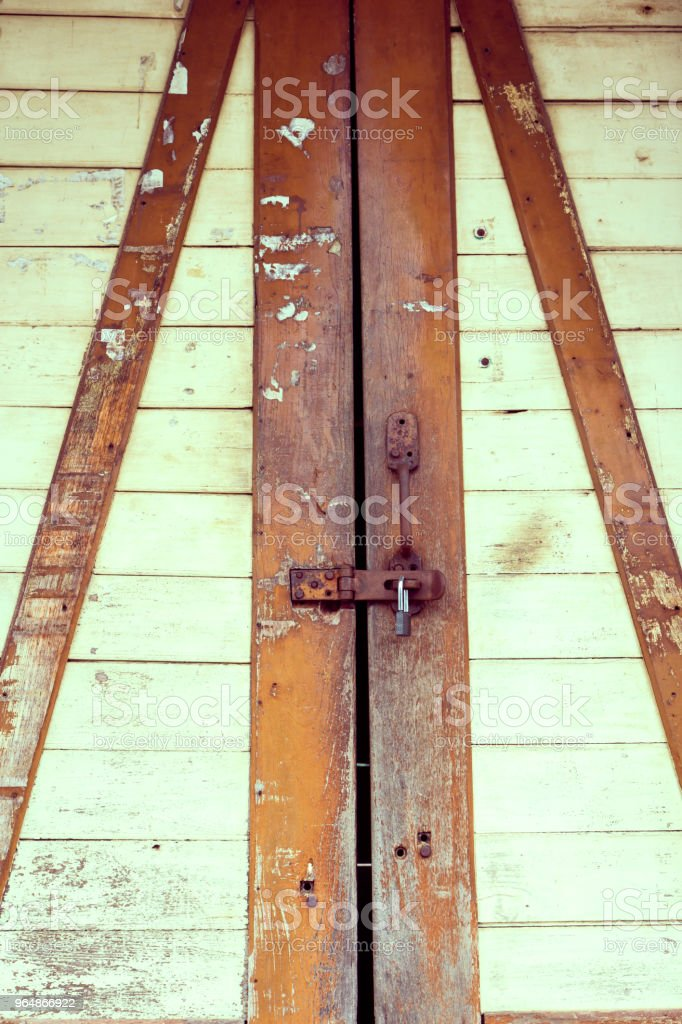 The padlock on an old wooden door royalty-free stock photo