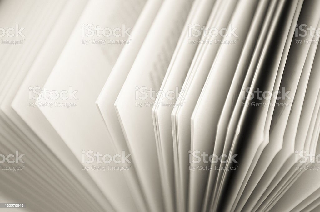 the pages of an open paperback book royalty-free stock photo