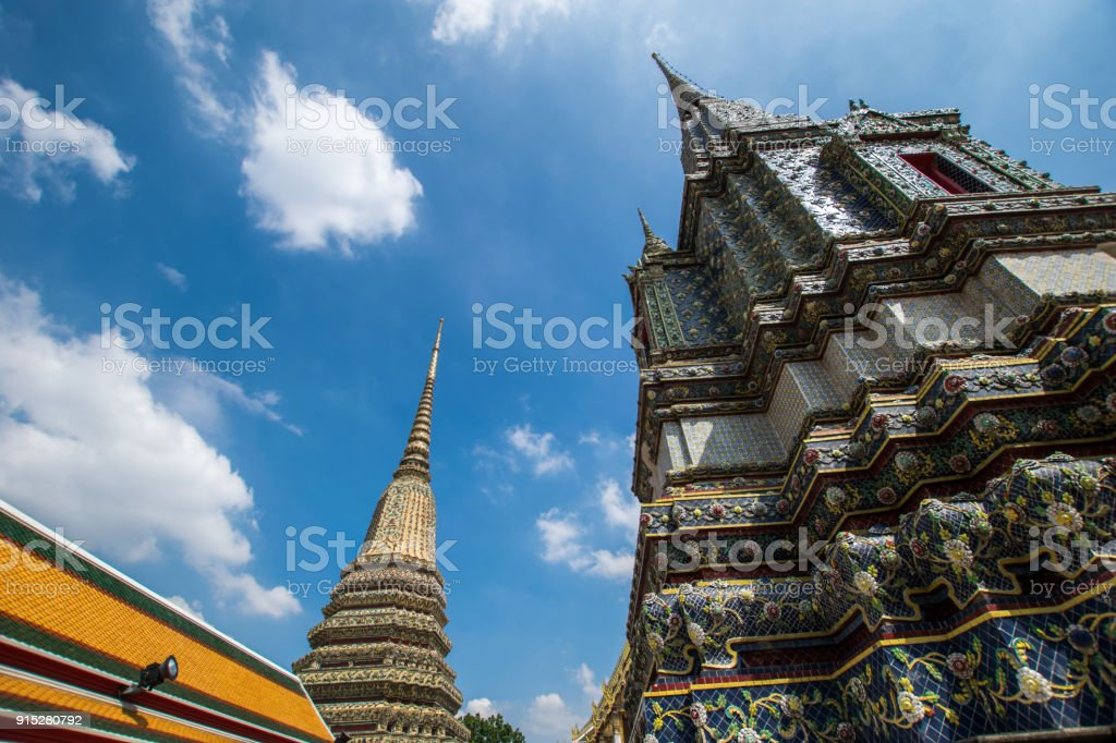 The Pagoda is in Wat Pho that was named as the temple of the pagoda or chedi that are decorated with yellow glaze or glazed tiles or dark blue. stock photo