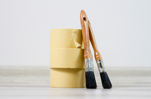 The Paint Brushes And Masking Tapes