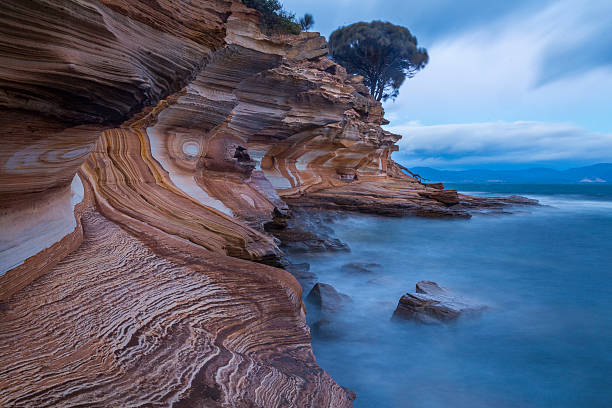 the painted cliffs on maria island, tasmania - tasmania stock pictures, royalty-free photos & images