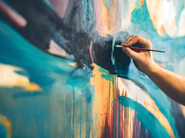 руки художника - краска стоковые фото и изображения