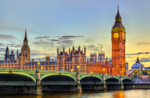 The Palace and the Bridge of Westminster in London at sunset - the United Kingdom The Palace of Westminster and Westminster Bridge in London, UNESCO world heritage in England central london stock pictures, royalty-free photos & images