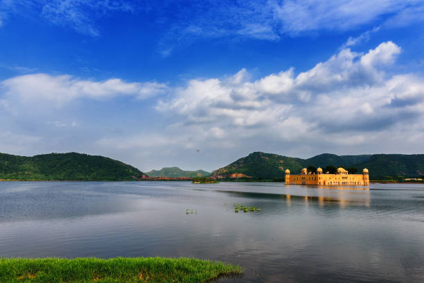 The Palace at the Lake in Jaipur The majestic building floating mysteriously in the calm waters under a beautiful sunset light, Jaipur, India lake pichola stock pictures, royalty-free photos & images