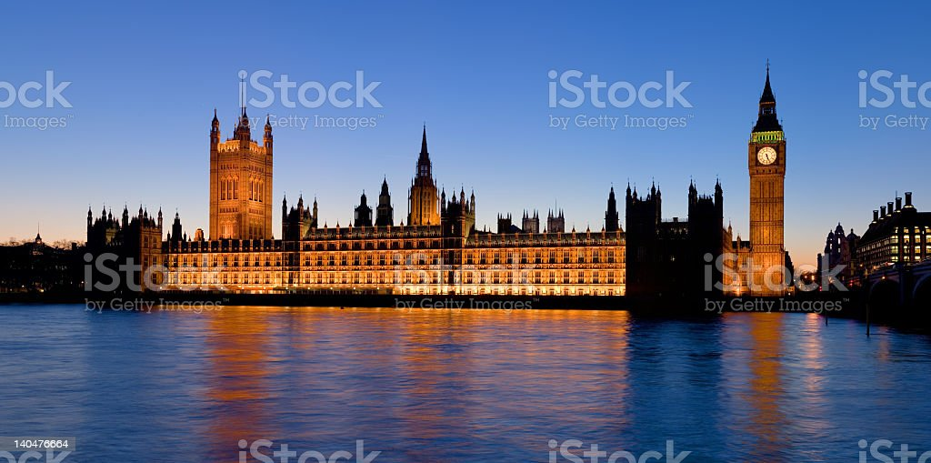 The palace of Westminster at dusk from water royalty-free stock photo