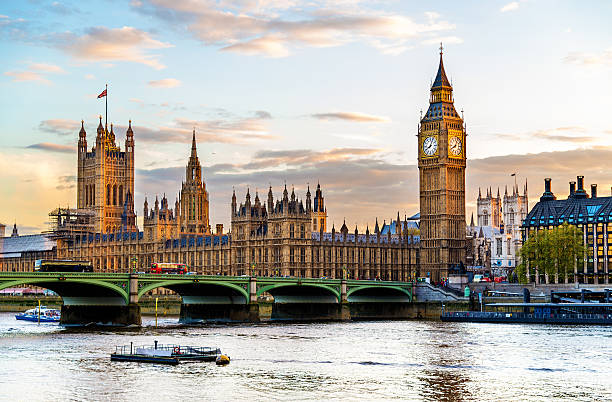 the palace of westminster in london in the evening - big ben stock photos and pictures