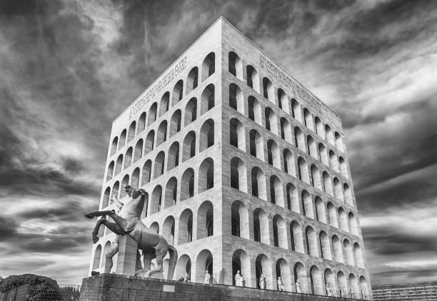 The Palazzo della Civilta Italiana, aka Square Colosseum, Rome, Italy ROME - MARCH 12:  The Palazzo della Civilta Italiana, aka Square Colosseum, in Rome, March 12, 2016. The monument lies in the EUR financial district in Rome quadrato stock pictures, royalty-free photos & images