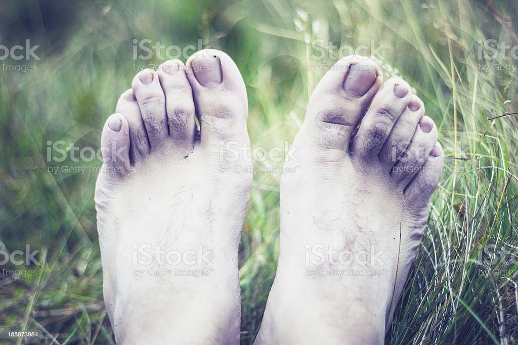 The pale and frozen feet of a young man stock photo