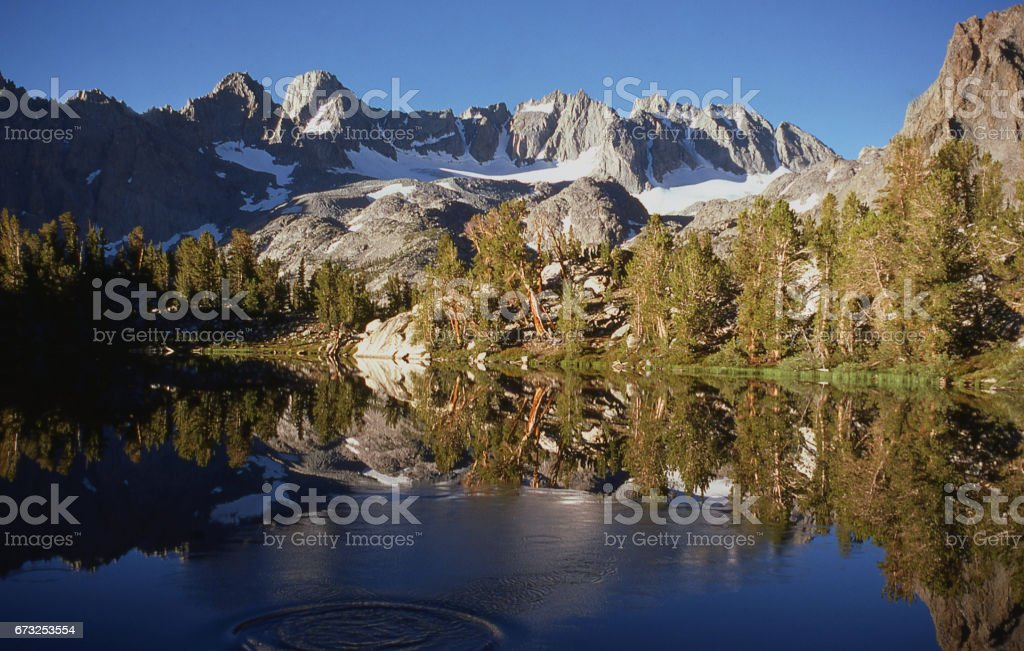 The Palisade Crest of the Sierra Nevada Mountains with Mount Sill the highest prominent peak and mountain lake early morning Big Pine California stock photo