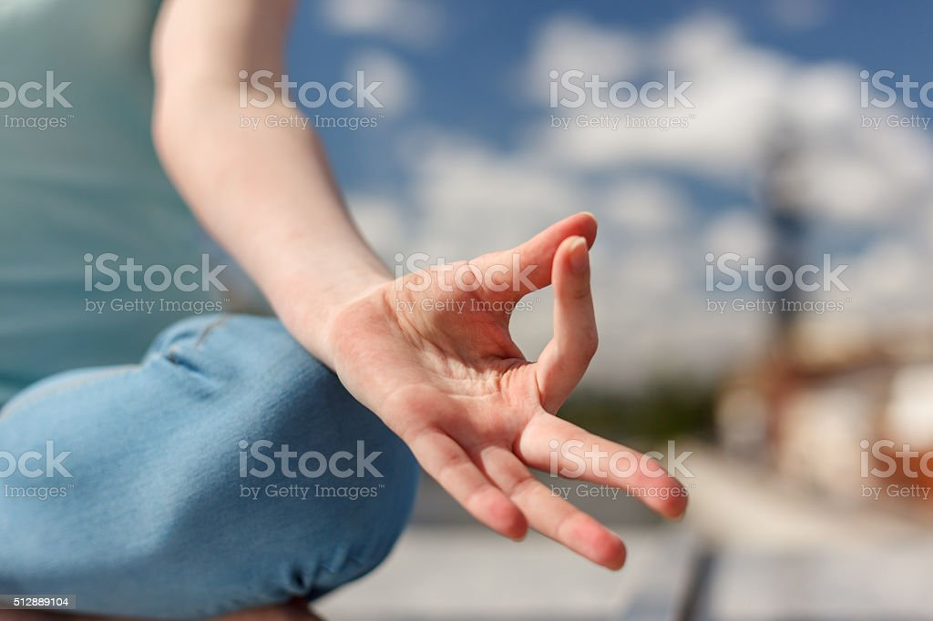 The palm in a gesture of concentration while meditating stock photo