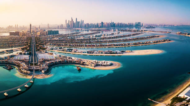 The Palm island panorama with Dubai marina in the background aerial The Palm island panorama with Dubai marina rising in the background aerial view dubai stock pictures, royalty-free photos & images