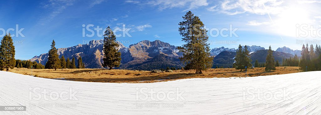 The panorama of ski slope with view on Dolomiti mountains stock photo