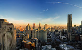 The panoramic scenic view to the Manhattan Downtown, over the Brooklyn Bridge and East River toward Brooklyn. The skyline includes the major buildings: Manhattan Municipal Building, New York by Gehry, Thurgood Marshall United Square Courthouse, One Brooklyn Bridge Plaza, and more. Aerial drone shot.
