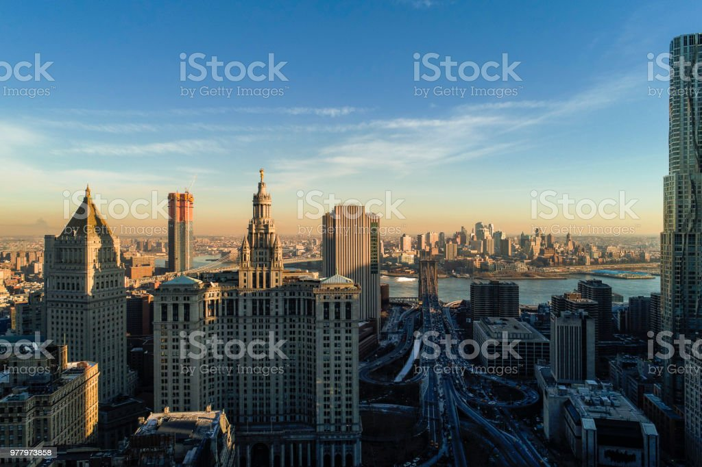 The panoramic scenic view to the Manhattan Downtown, over the Brooklyn Bridge and East River toward Brooklyn. The skyline includes the major buildings: Manhattan Municipal Building, New York by Gehry, Thurgood Marshall United Square Courthouse, One Brookl stock photo