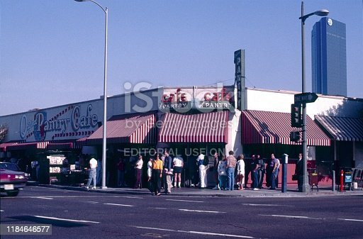 Los Angeles, California, USA, 1986. The Pantry Cafe on the corner of 9th and Figueroa in the South Park District. In front of the cafe customers wait in line to get a coffee or a seat.