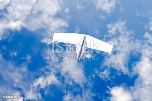 658921430 istock photo the paper plane in the sky 499907491