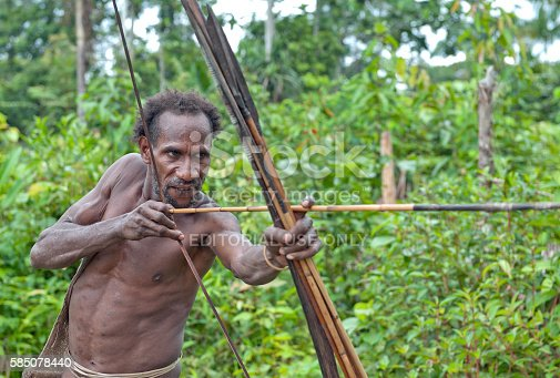 841481956istockphoto The Papuan from a Korowai tribe 585078440