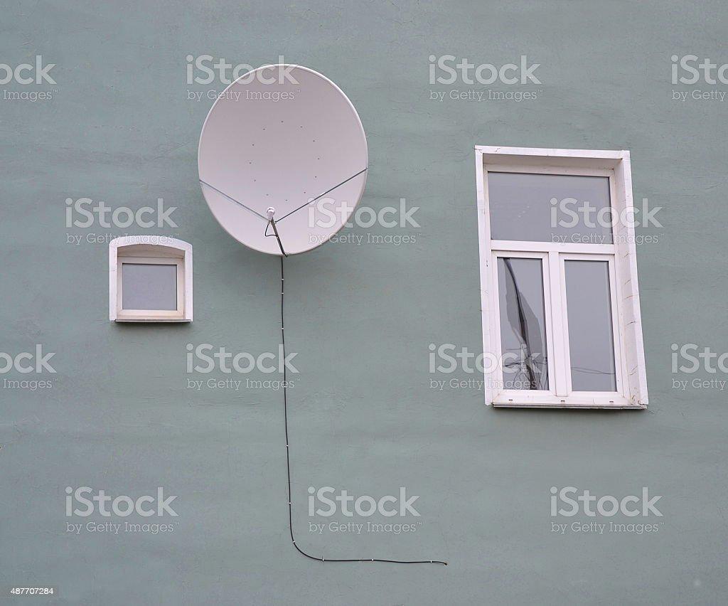 The parabolic antenna on a wall stock photo
