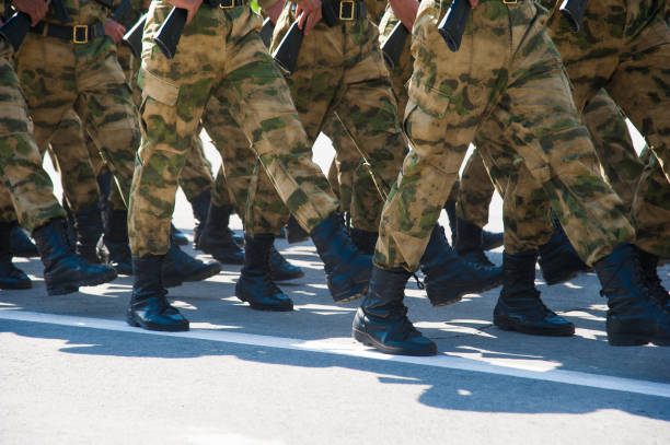 The parade of soldiers Soldiers in dress uniform marching in the parade military parade stock pictures, royalty-free photos & images