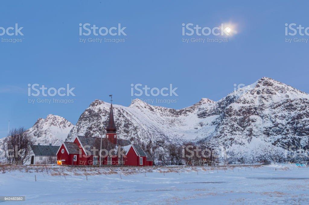 The parish church in Flakstad in the snowy mountains of Lofoten, stock photo