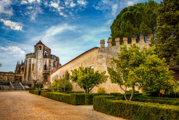 the park leading to the round templar church of the convent of christ, tomar, portugal - knights templar stock pictures, royalty-free photos & images