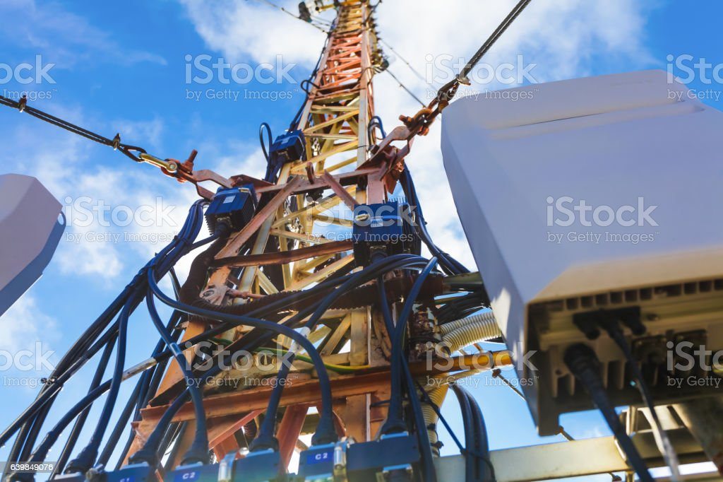 The part of telecommunication tower  with installed communications equipment stock photo