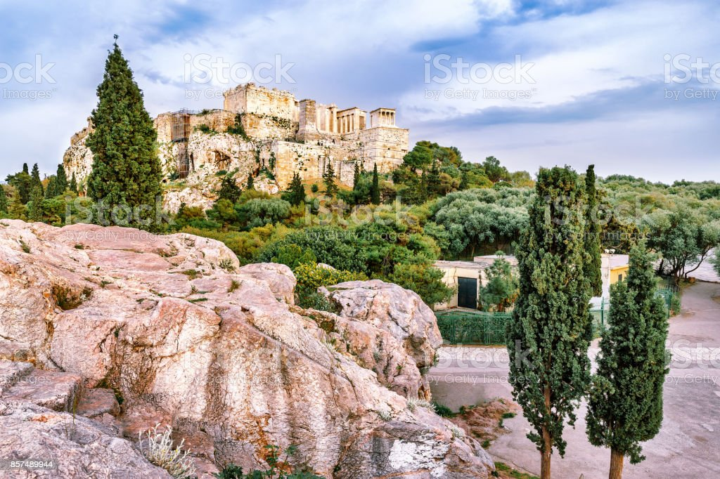 The Parthenon, view from Philosophic stone over cypress trees. Modern days, Restored ancient Greek ruins, extremely famous and popular travel destination in Athens, Greece, Europe. stock photo