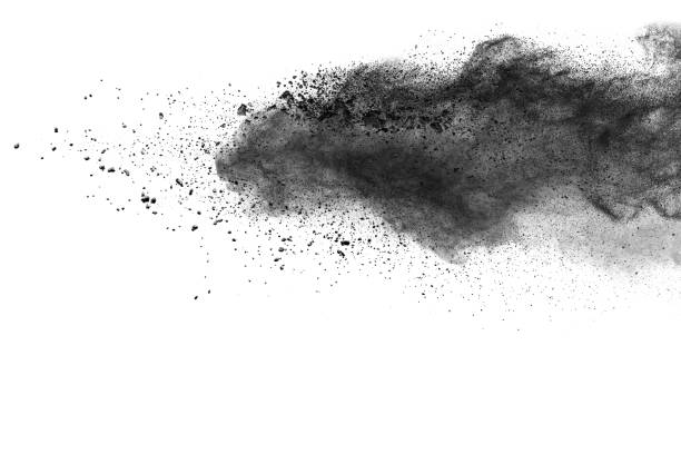 The particles of charcoal splattered on white background stock photo