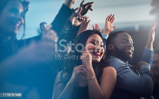 Cropped shot of an energetic young couple dancing together  at a party at night