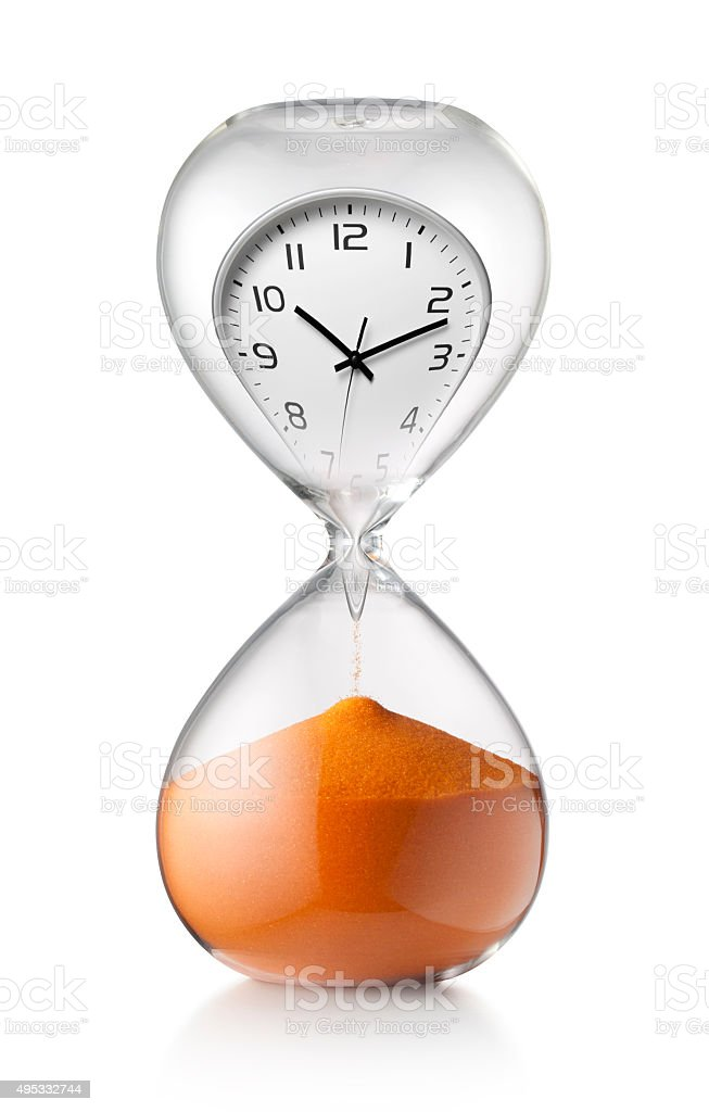 The passage of time. Hourglass with clock. stock photo