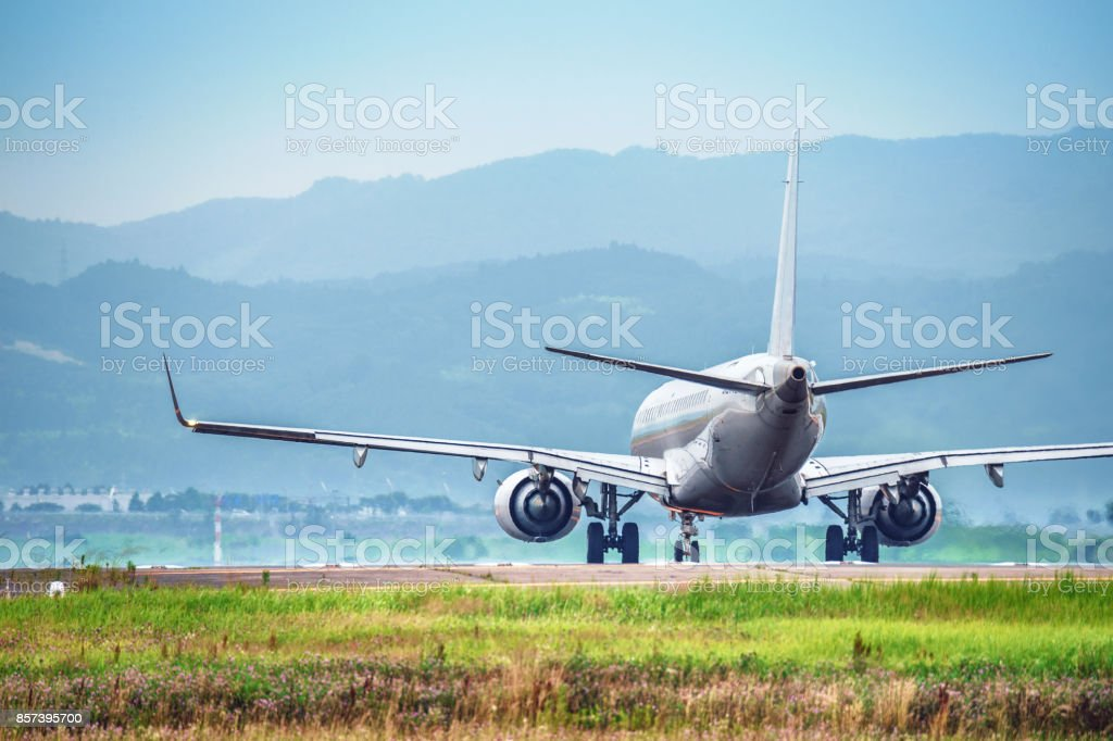The passenger plane which takes off stock photo