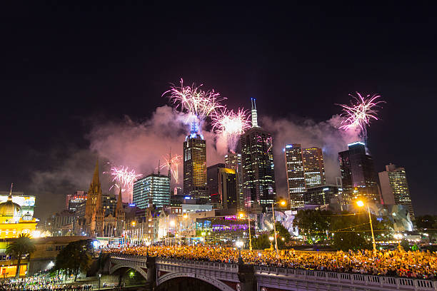 The passing of the old year New Year's Eve Fireworks 2013 in Melbourne, Australia with St Paul's Cathedral and Princes Bridge. 2013 stock pictures, royalty-free photos & images