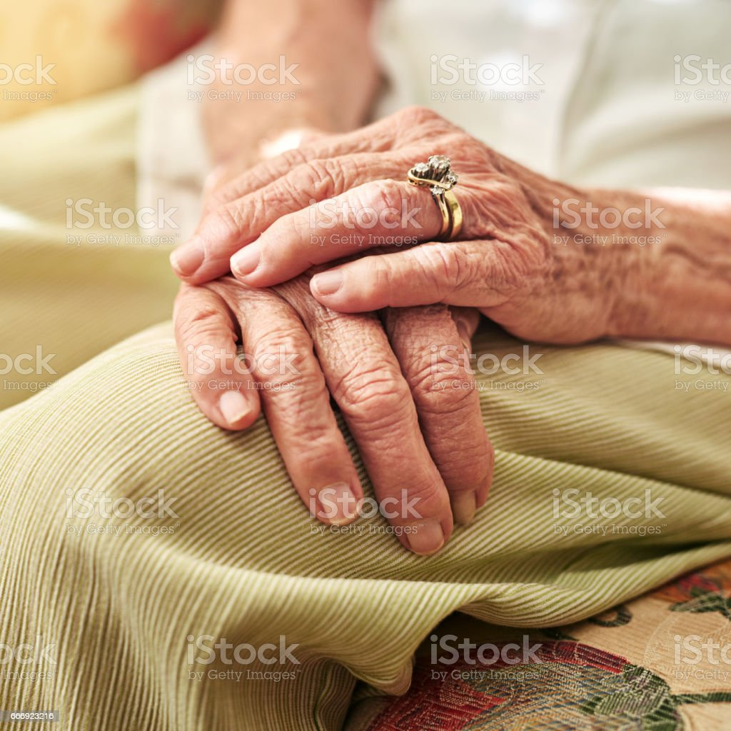 The passing of time can be seen in the hands stock photo