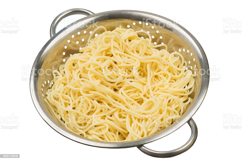 the pasta in a colander cooked stock photo