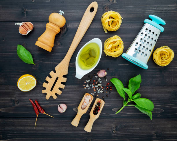 The  pasta on black wooden background. Yellow italian pasta with ingredients. Italian food and menu concept. stock photo