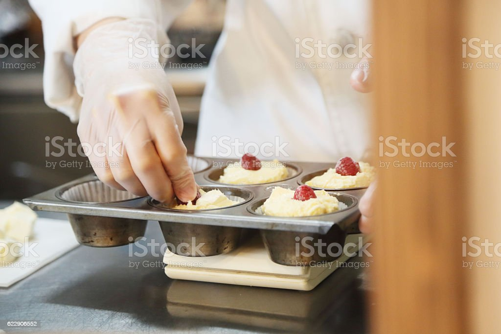 The pastry chef who cooks a cake stock photo