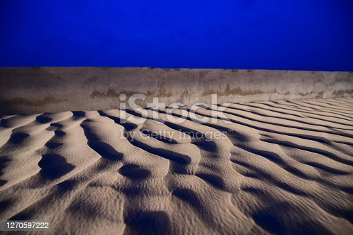 The pattern of sand created by the wind