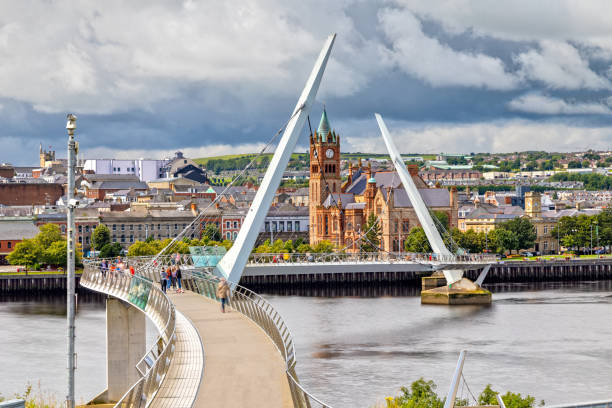 The Peace Bridge and Guildhall in Londonderry / Derry in Northern Ireland stock photo