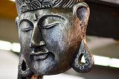 Stone statue of Buddha isolated