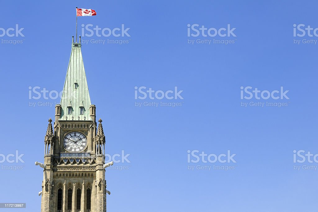 The peace tower with a Canadian flag waving in the air royalty-free stock photo