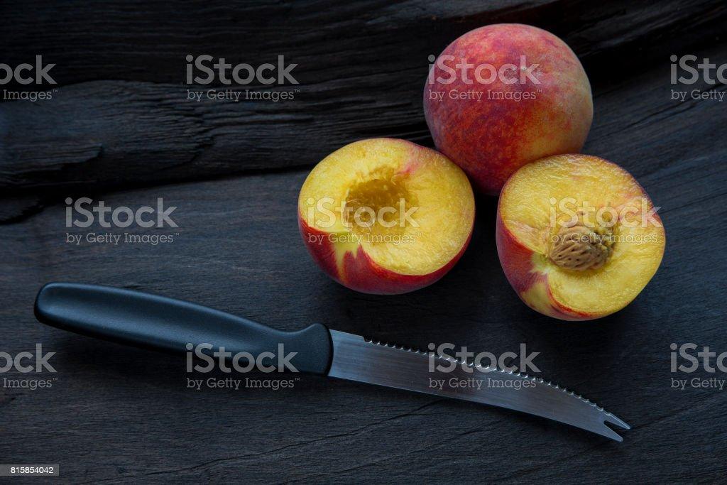 The Peach cut in half stock photo
