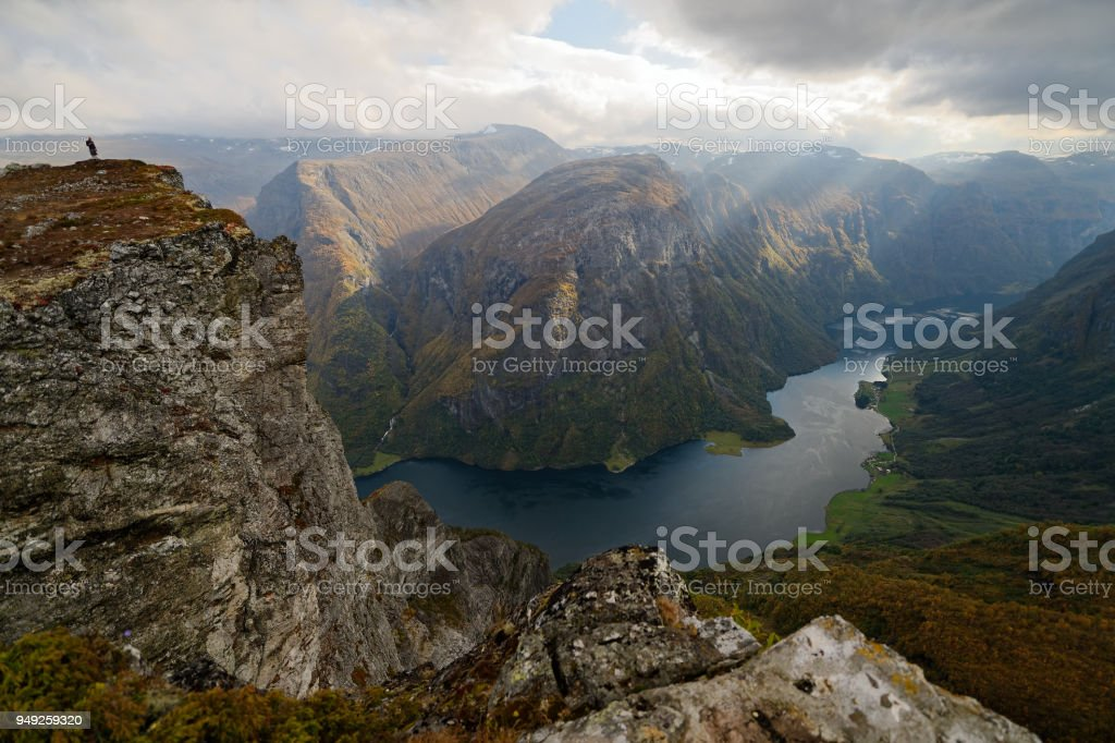 The peak of Breiskrednosi over Nærøyfjord stock photo