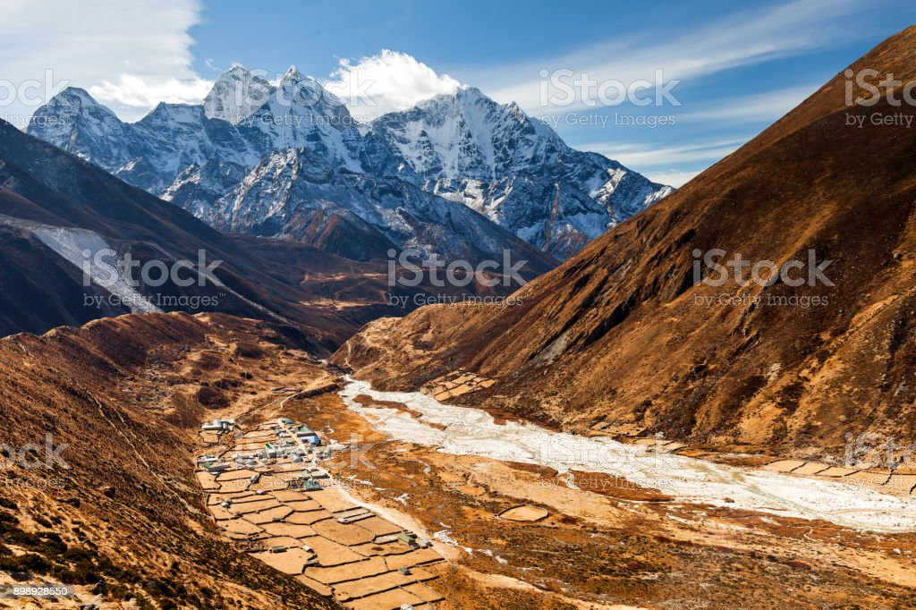 The peak of Mount Ama Dablam seen from Dingboche Village on Everest Highway in Nepal stock photo