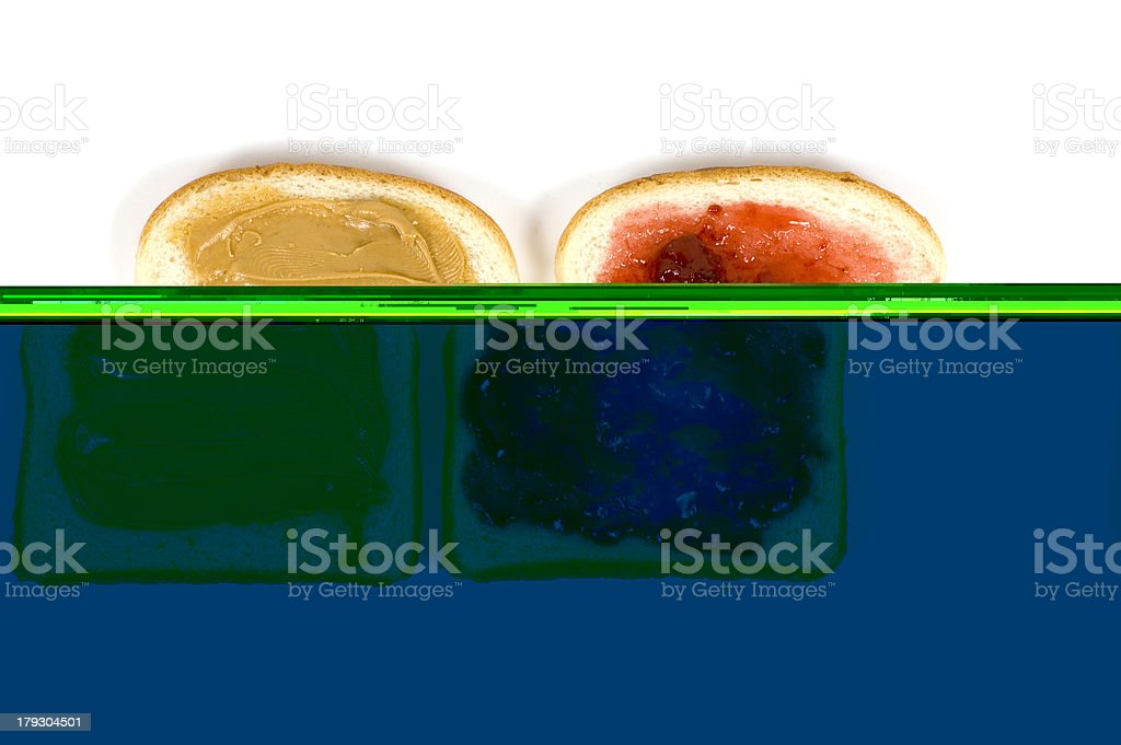 The Peanut Butter and Jam spread on to the bread slices stock photo